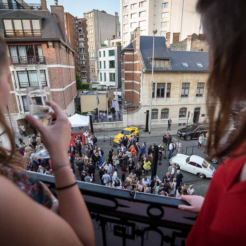 Event Photography: Guests watch from a terrace during an art exhibition by Sotheby's in Brussels