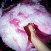 Street Photography - 2016. Image 8 of 24. Taken in Brussels, Belgium by Dani Oshi. Close up flash street photograph of a big cotton candy from a bellow perspective being held by a hand