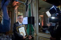 An award winner has an interview in front of a camera during the McKinsey Awards event in Brussels