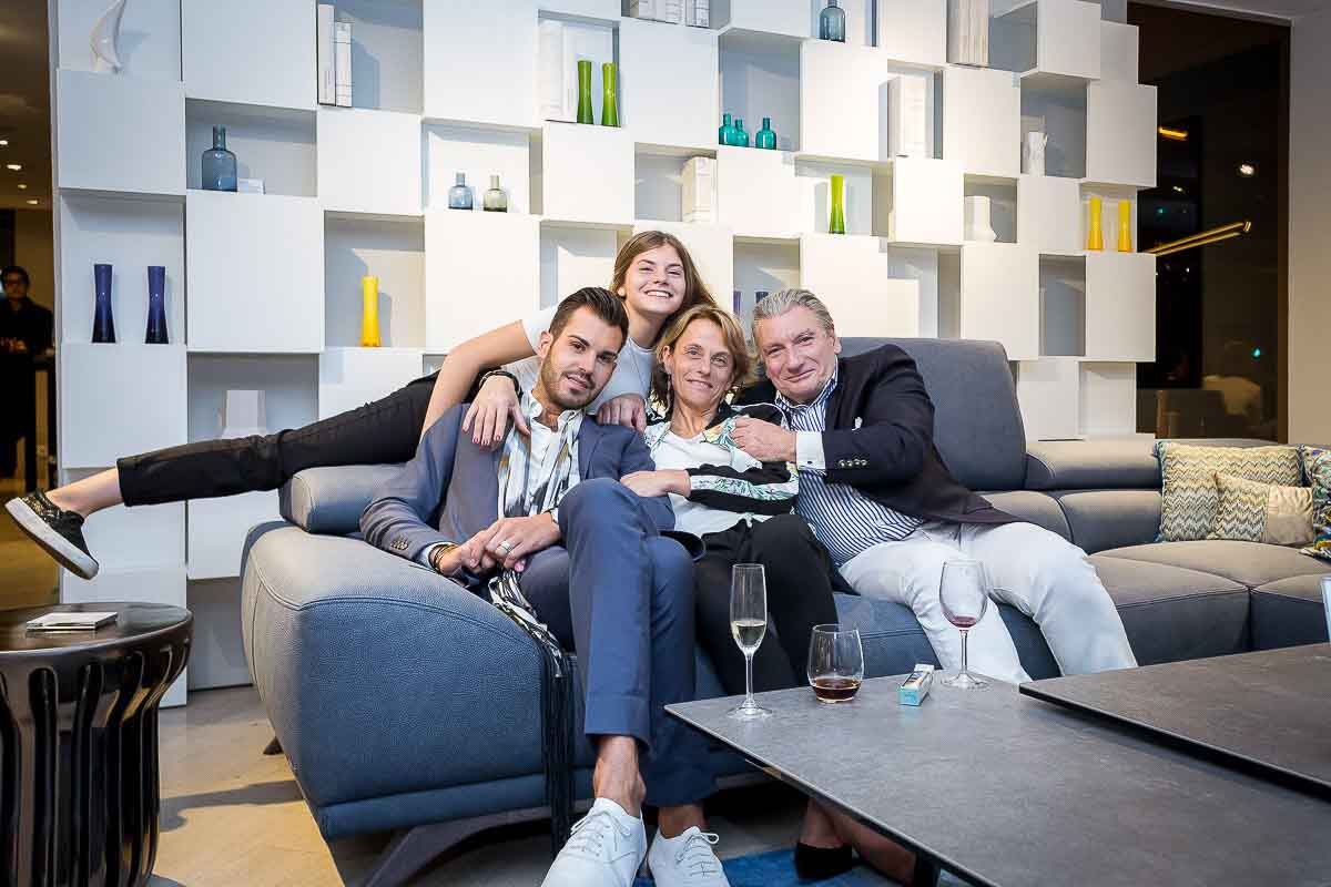 A family group posing during an event for Roche Bobois in Brussels