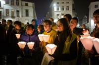 A group of people with candles in hand during 'For the Voiceless' manifestation event in Brussels