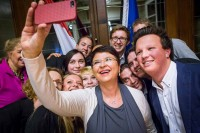 A group of people taking a selfie during an event at the Vienna House, Brussels