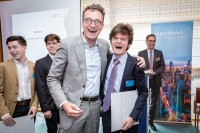 Pascal Smet laughs and hugs a student during the Sci Tech Challenge ceremony event in Brussels