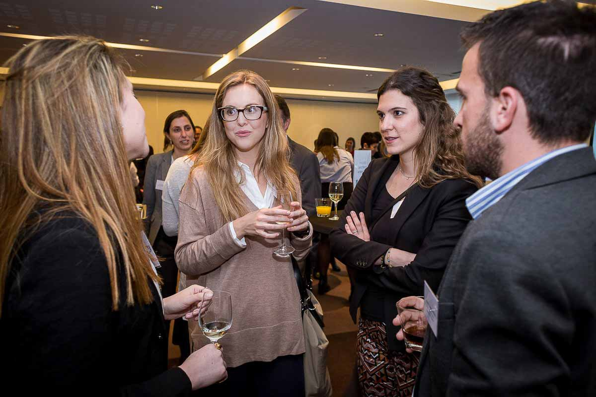A group of people talking during an event to award Zabala as company of the year