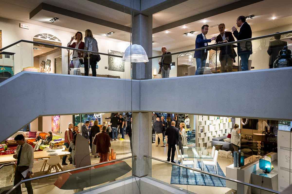 Building of Roche Bobois from inside showing guests during a night event in Brussels