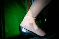 Close up flash street photograph of a woman's ankle wearing panties and a anklet