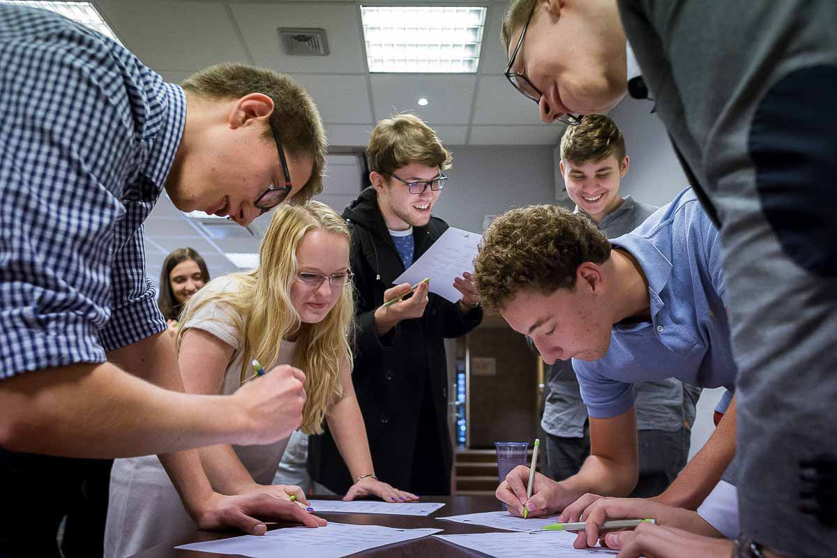 A group of students debating in a workshop during the Leaders for a Day in Brussels