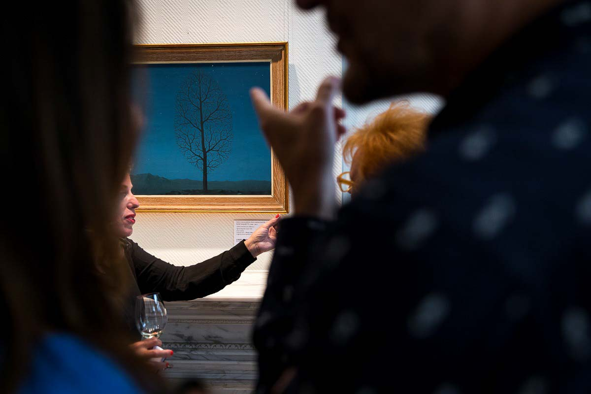 Visitors appreciating art during an art exhibition event by Sotheby's in Brussels
