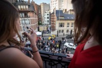 Guests watch from a terrace during an art exhibition event by Sotheby's in Brussels