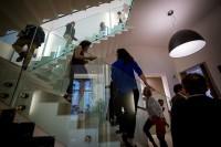 Guests go up and down stairs during an art exhibition event by Sotheby's in Brussels