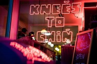 Neon lights in the front window of Knees to Chin restaurant in Sainte-Catherine, Brussels