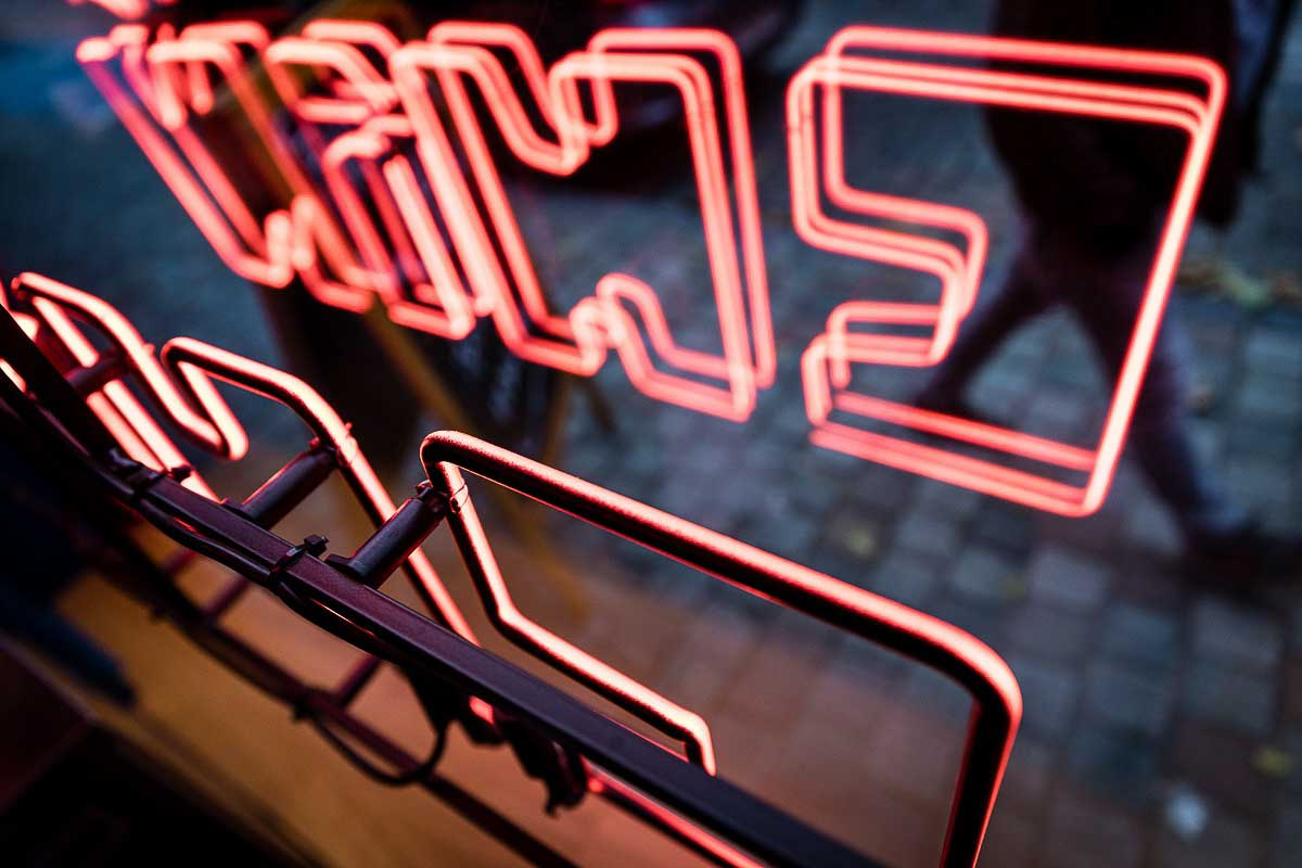 Detail of the neon lights in the front window of Knees to Chin restaurant in Sainte-Catherine