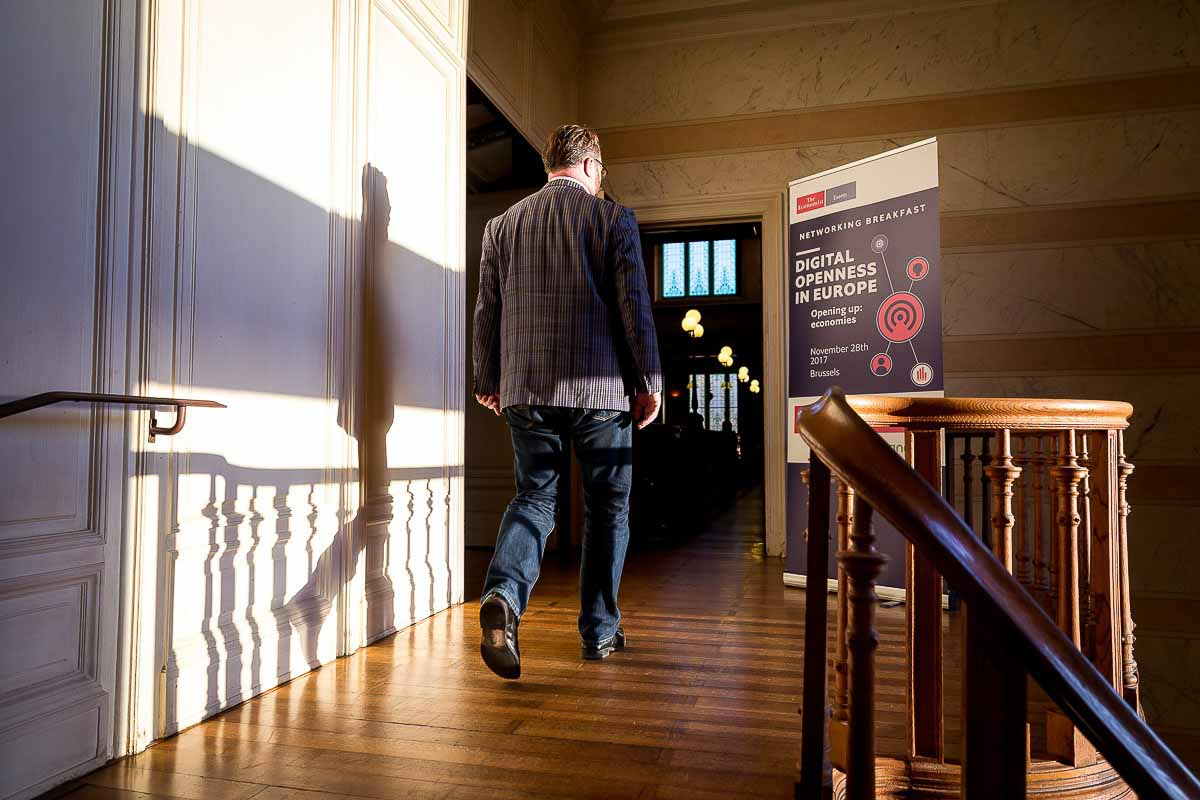 A man walks to the networking area during the The Economist Digital Openness in Europe conference