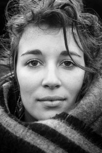 Black and white closeup portrait of a woman from France taken in Brussels