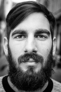 Black and white closeup portrait of a man with a beard from Italy taken in Brussels
