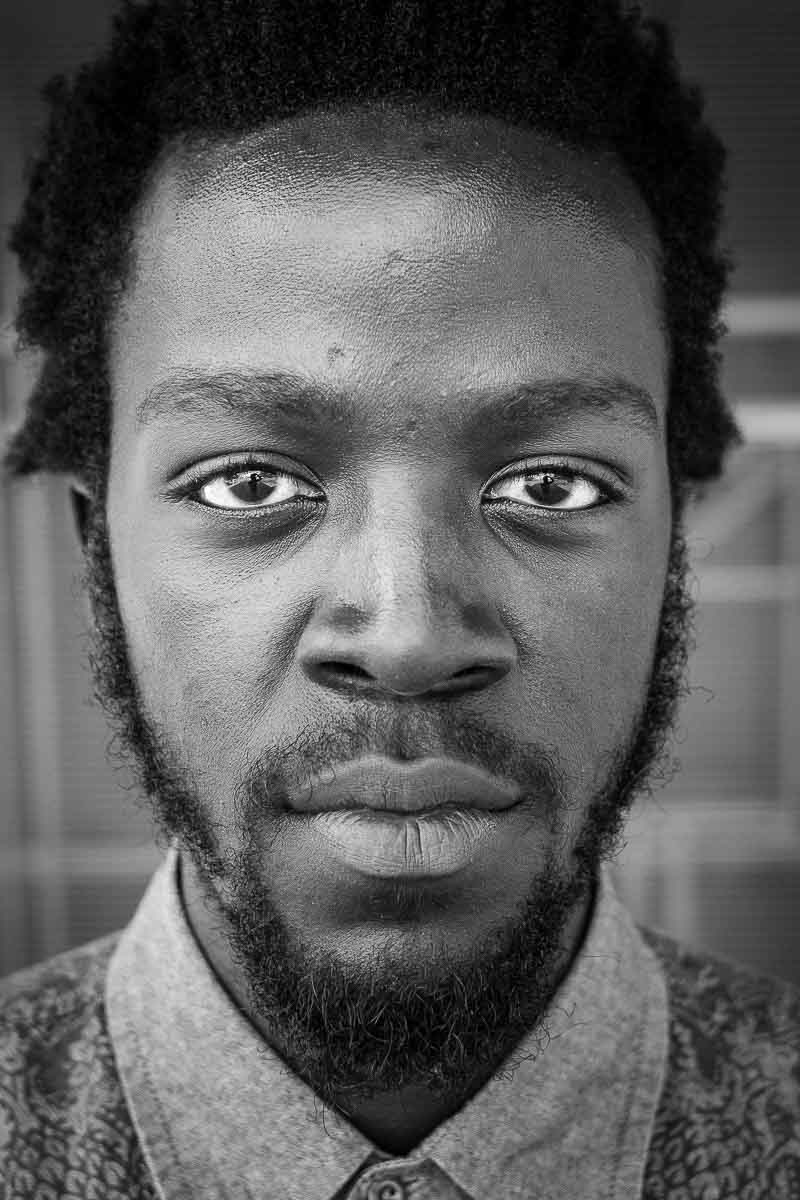 Black and white closeup portrait of a man with a beard from Rwanda taken in Brussels