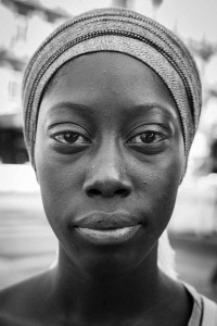Black and white closeup portrait of a woman from Senegal taken in Brussels
