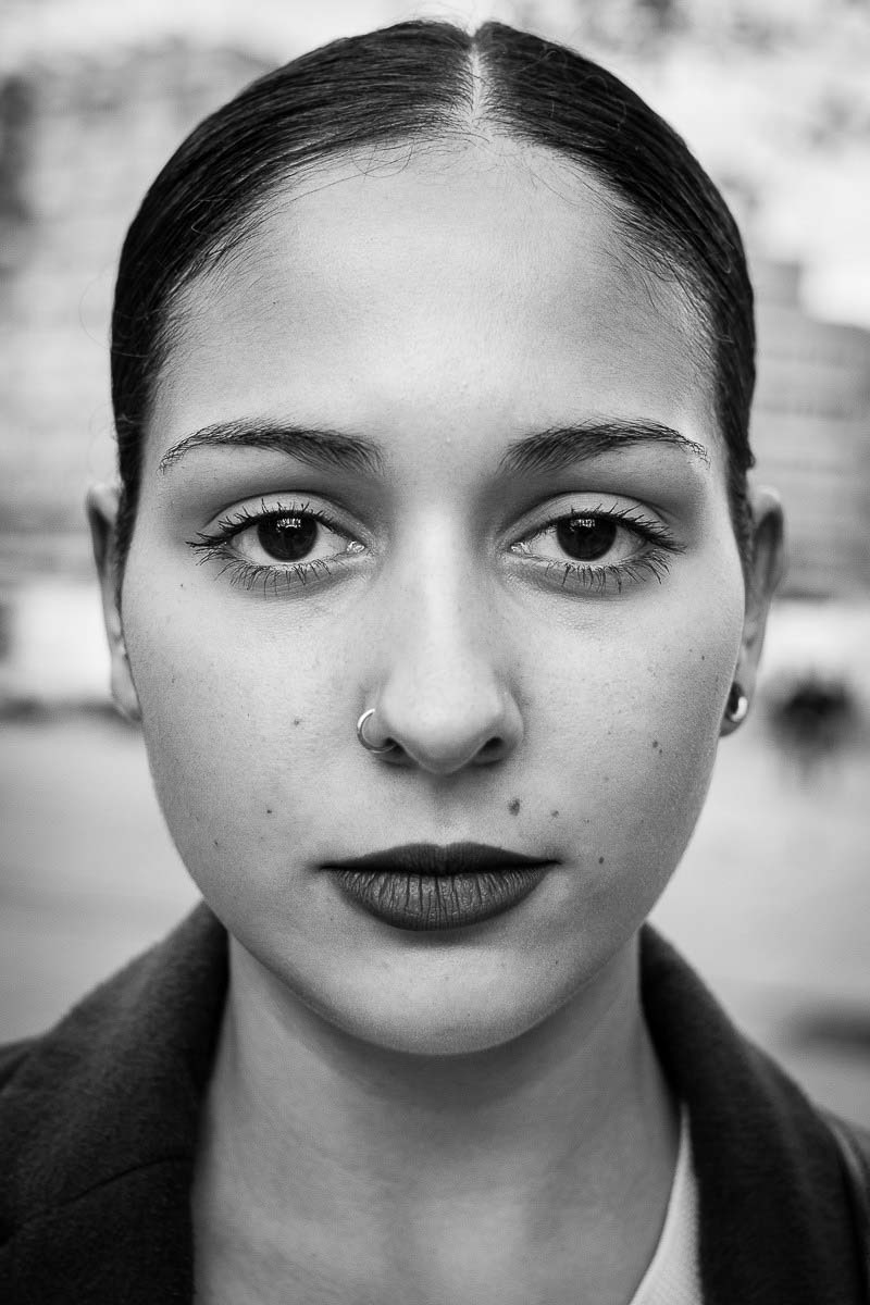 Black and white closeup portrait of a woman from spain taken in brussels