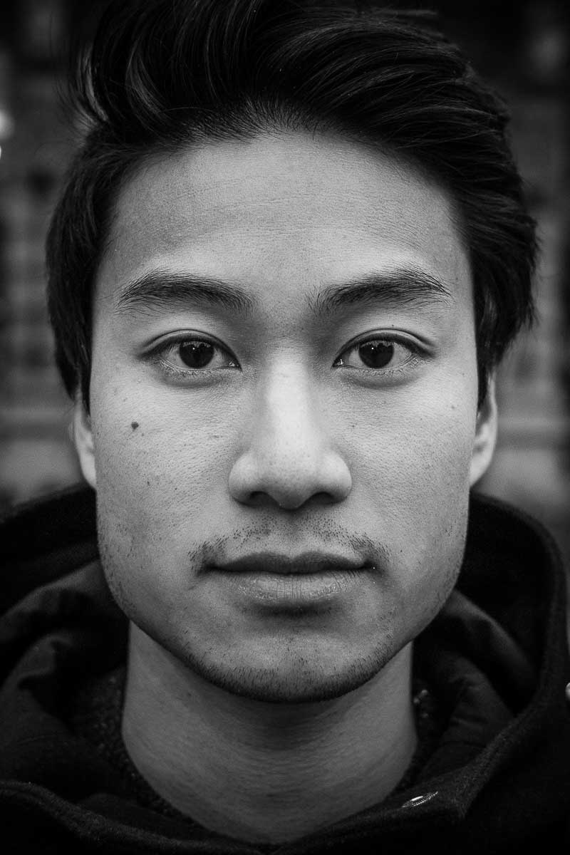 Black and white closeup portrait of a man from Vietnam taken in Brussels