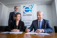 Former and current president of EURADA signing a document during a meeting in Brussels