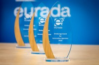 Prizes in front of an EURADA banner background during an event in Brussels for EURADA
