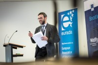 A speaker giving his lecture during an event for EURADA in Brussels