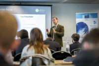 A speaker engages the audience during a workshop event for EURADA in Brussels