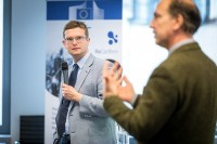 The moderator looks at one of the speakers during a workshop event for EURADA