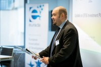 A speaker addressing the audience during a workshop for EURADA in Brussels