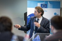 A speaker shows his slides to the audience during a workshop event for EURADA