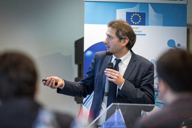 Photography assignment for EURADA: Workshop on Investment Platforms. Photo of one of the speakers pointing at his presentation. Taken on Wednesday, February 21, 2018, in Orega, Brussels by Dani Oshi.