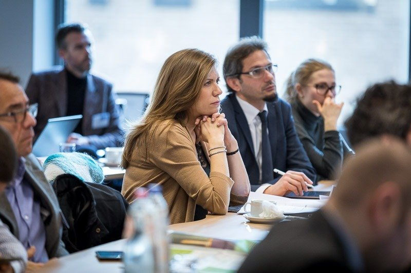 Photography assignment for EURADA: Workshop on Investment Platforms. Photo of a woman from the audience looking attentively to the speaker. Taken on Wednesday, February 21, 2018, in Orega, Brussels by Dani Oshi.