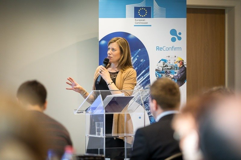 A speaker engages with the audience during a workshop event for EURADA in Brussels