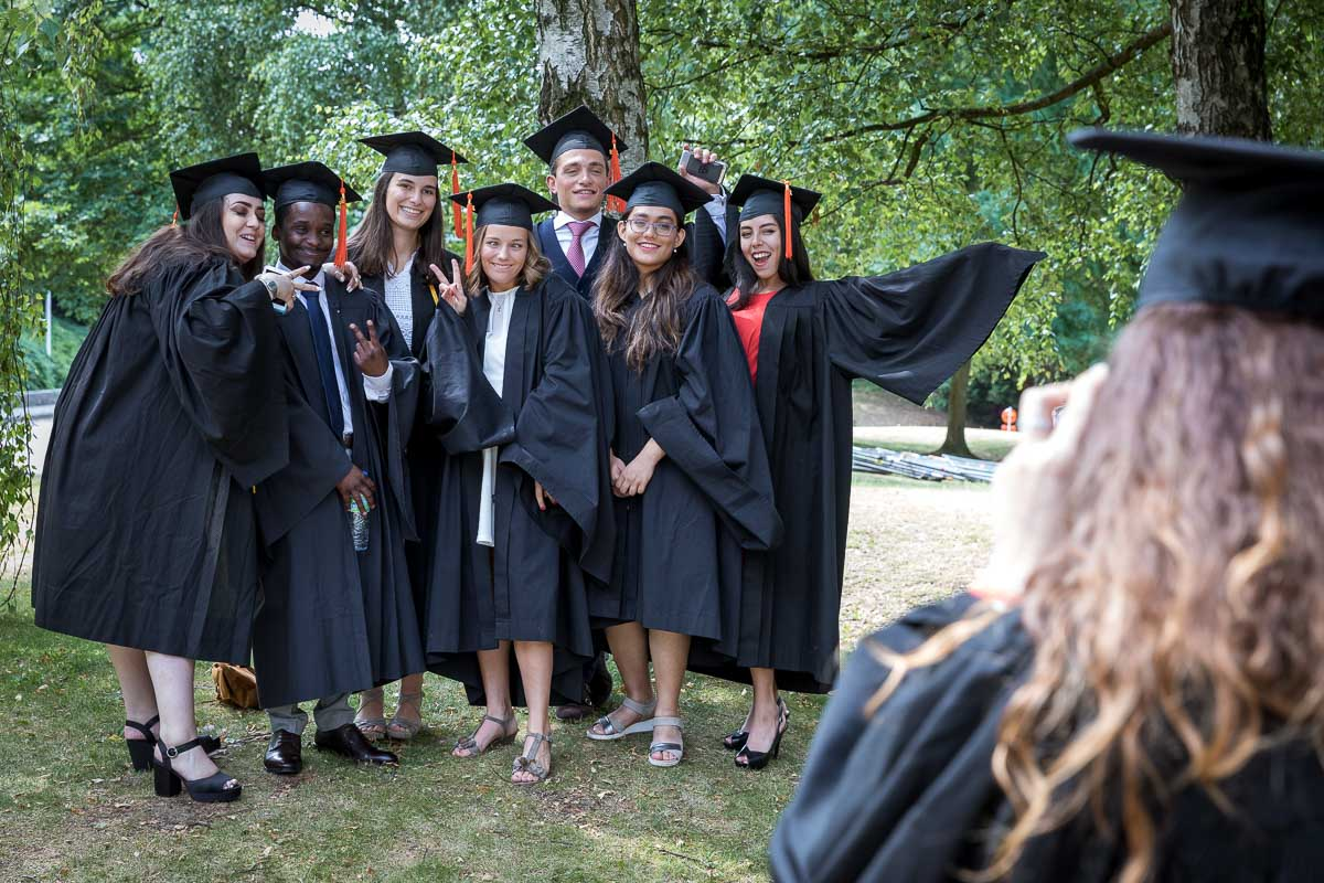 A group of Vesalius College bachelors pose in their graduation day in Brussels
