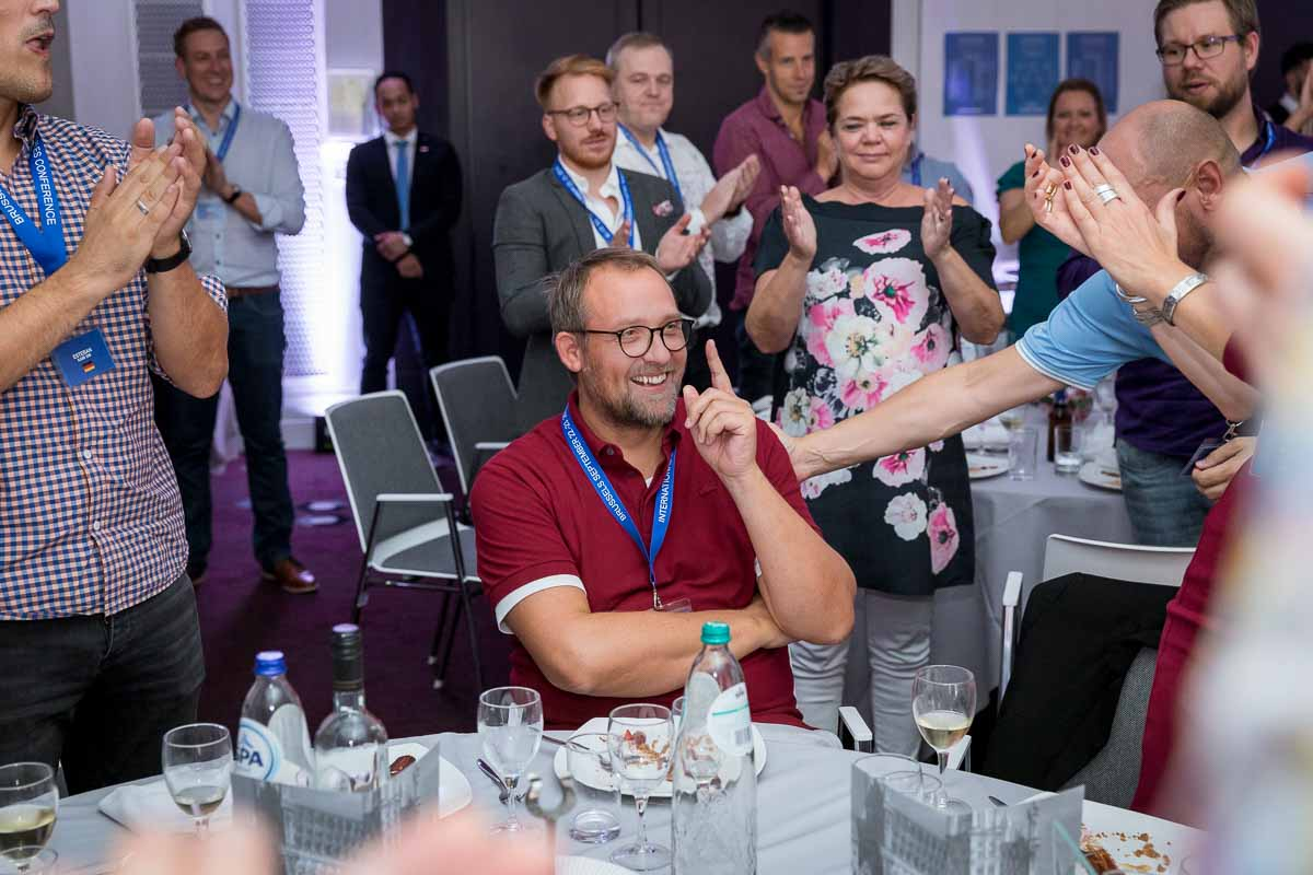 JS World Media CEO Jens Stausholm is applauded before receiving a prize during an event in Brussels