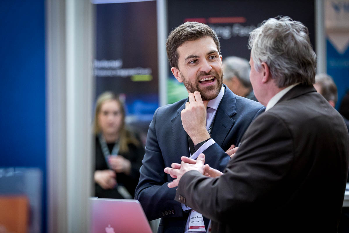 Closeup of a man networking during the 2018 CS International Conference in Brussels