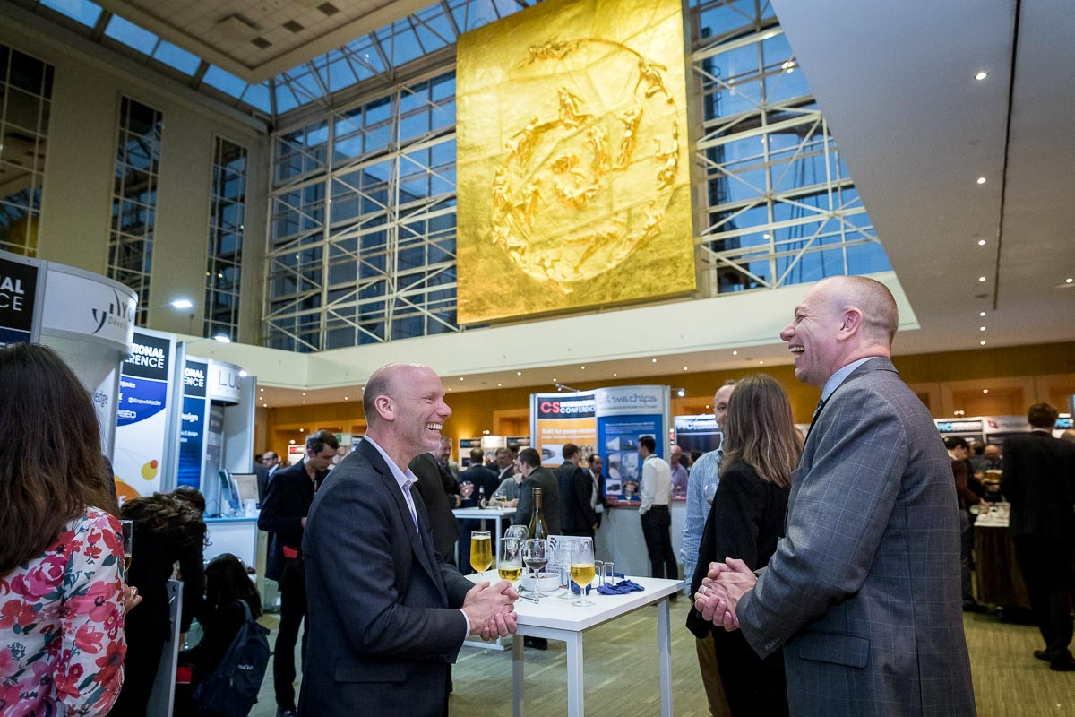 Two men talking and networking during the 2018 CS International Conference in Brussels