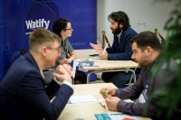 People engaging during a networking event for EURADA and Watify in Brussels