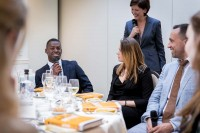 A student laughing as he speaks during a gala dinner event for JA Europe in Brussels