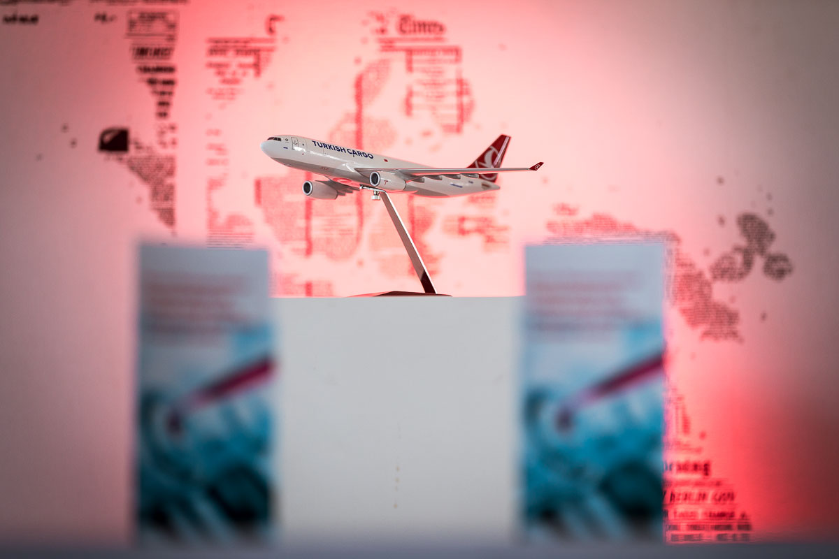 A Turkish Cargo model aircraft in front of a red wall