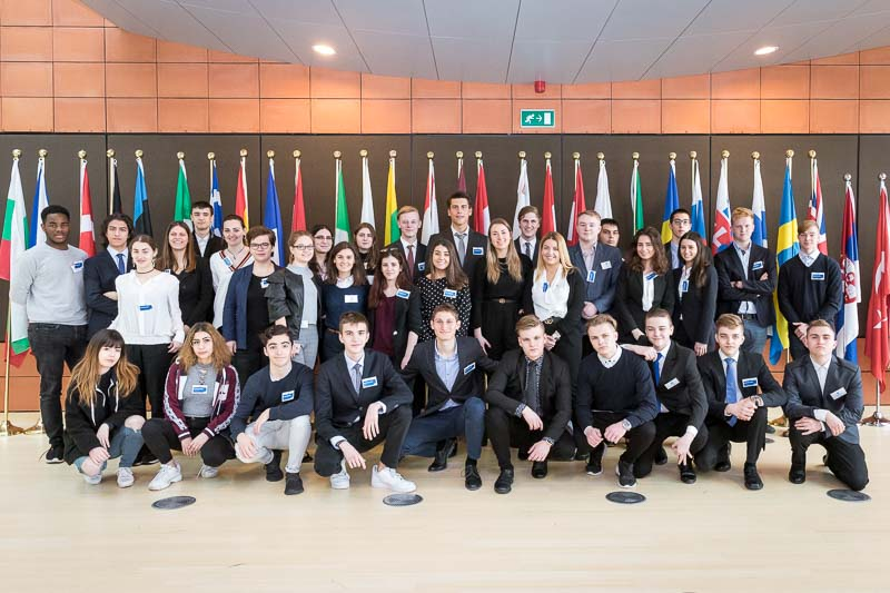 Group picture of students inside the EU Parliament during the Why Europe Matters 2018 for JA Europe
