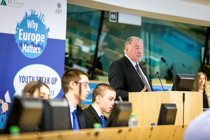 Man giving a speech in the EU Parliament during the Why Europe Matters 2018 for JA Europe