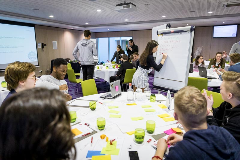 Students using post-its and a white paper board during the Why Europe Matters 2018 for JA Europe