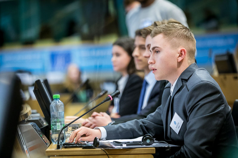 A student giving a speech in the EU Parliament during the Why Europe Matters 2018 for JA Europe