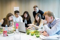 Group of students discussing on a round table during the Why Europe Matters 2018 for JA Europe