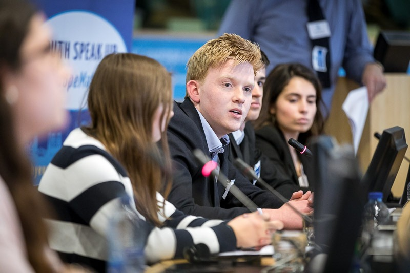A student gives a speech in the EU Parliament during the Why Europe Matters 2018 for JA Europe