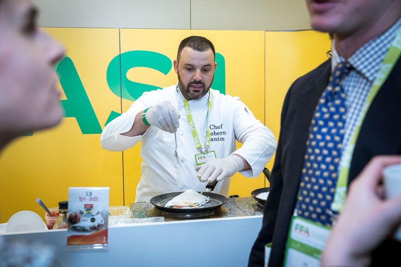 A cook prepares Tapioca and amuses visitors during an event for APEX Brasil in Brussels