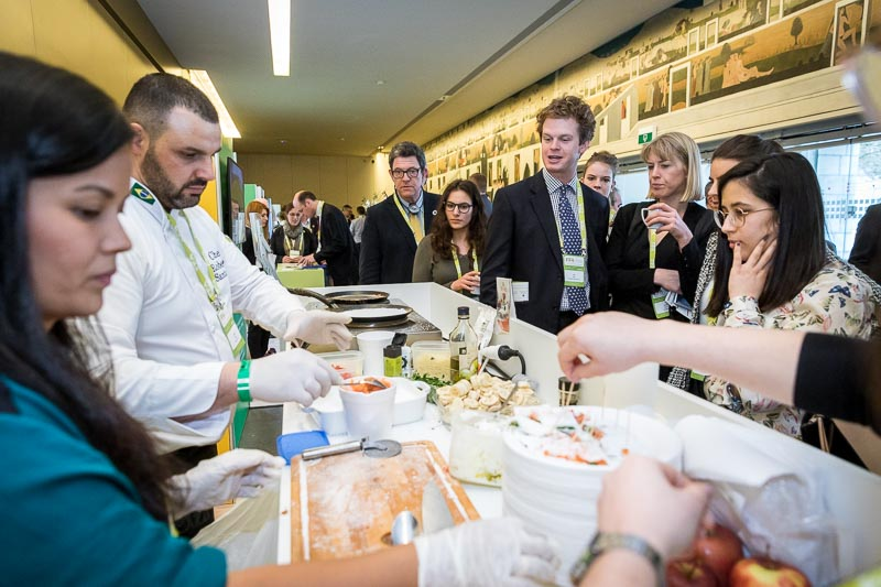 A cook preparing Tapioca for a large audience during an event for APEX Brasil in Brussels
