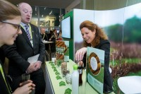 A sugar importer at her kiosk chatting with visitors during an event for APEX Brasil in Brussels