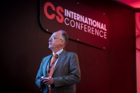 A speaker looks at his slides during his presentation at the CS International Conference 2018